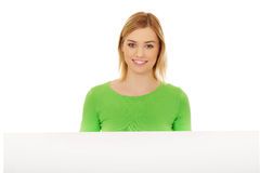 Happy woman with blank board. Royalty Free Stock Photography