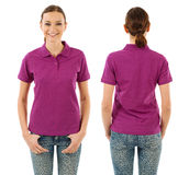 Happy woman with blank purple polo shirt Royalty Free Stock Photo