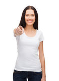 Happy woman in blank white t-shirt pointing at you Royalty Free Stock Images