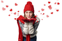 Happy woman blowing kiss with hearts Stock Photo