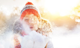 Happy woman blowing snow in winter nature Stock Photo