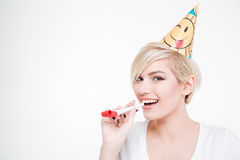 Happy woman blowing in whistle Stock Images