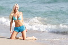 Happy woman in blue bikini on sea background Royalty Free Stock Photography