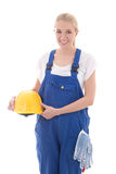 Happy woman in blue builder uniform holding yellow helmet isolat Stock Images
