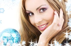 Happy woman with blue christmas ball Stock Photography