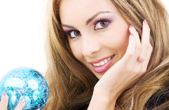 Happy woman with blue christmas ball Royalty Free Stock Photo