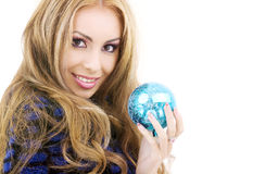 Happy woman with blue christmas ball Royalty Free Stock Photos