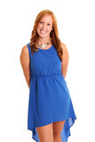 Happy woman in a blue dress. Red hair feeling great in a studio setting. White background Stock Image