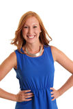 Happy woman in a blue dress. Red hair feeling great in a studio setting. White background Royalty Free Stock Photography