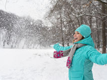 Happy woman in blue jacket at the winter park. Stock Images