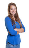 Happy woman in a blue shirt with crossed arms Royalty Free Stock Images