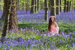 Happy woman in bluebells forest Royalty Free Stock Images