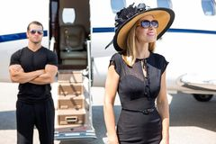 Happy Woman With Bodyguard And Private Jet In stock photography