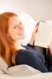 Happy Woman with a Book at Home Stock Photo