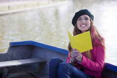 Happy woman with book outdoors Stock Images