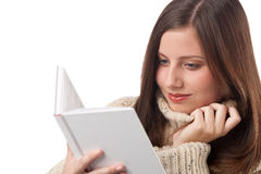 Happy woman with book wearing turtleneck Royalty Free Stock Photos