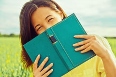 Happy woman with book Stock Images