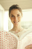Happy woman with book. Happy young woman reading a book Stock Photography