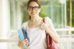 Happy woman with books Royalty Free Stock Image
