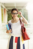 Happy woman with books Stock Photo
