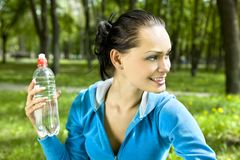 Happy woman with bottle Stock Images