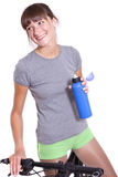 Happy woman with bottle and bike Stock Photography