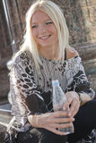 Happy woman with bottle of water Royalty Free Stock Photography