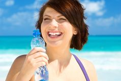 Happy woman with bottle of water Stock Photo