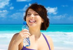 Happy woman with bottle of water Royalty Free Stock Image