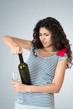 Happy woman with bottle of wine Stock Photography