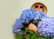 Happy woman with bouquet of hydrangea stock photos