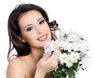 Happy woman with bouquet of flowers royalty free stock images