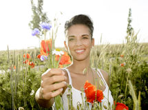Happy woman with bouquet Stock Images