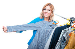 Happy woman in boutigue choosing shirt Stock Photos