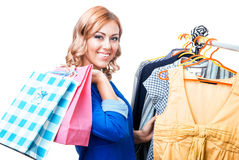 Happy woman in boutigue choosing shirt Stock Images