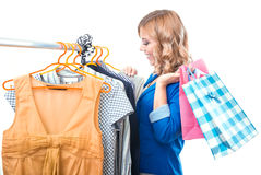 Happy woman in boutigue with shopping bags Royalty Free Stock Images