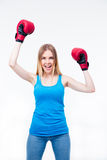 Happy woman with boxing gloves Royalty Free Stock Photography