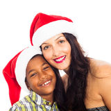 Happy woman and boy in Christmas hat Royalty Free Stock Photography