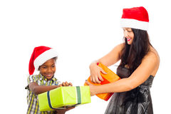 Happy woman and boy opening Christmas gifts Royalty Free Stock Photography