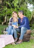 Happy Woman With Boyfriend At Campsite. Portrait of happy women with boyfriend sitting on chairs at campsite stock images