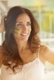 Happy woman with Brazilian flag Stock Photography