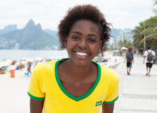 Happy woman in brazilian jersey at Rio de Janeiro Royalty Free Stock Photo
