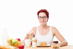 Happy woman at breakfast with a coffee Stock Photography