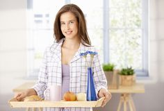 Happy woman with breakfast tray Stock Photos