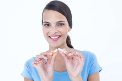 Happy woman breaking a cigarette Stock Photos