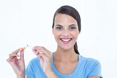 Happy woman breaking a cigarette Royalty Free Stock Image
