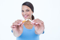 Happy woman breaking a cigarette Royalty Free Stock Images