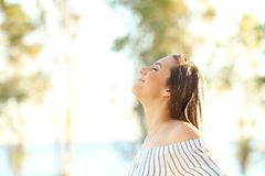 Happy woman breathing fresh air outside Stock Photography