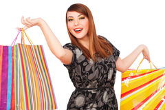 Happy woman with bright shopping bags Royalty Free Stock Photography