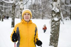 The happy woman in a bright yellow cap and a jacke Royalty Free Stock Photos